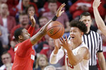 Nebraska's Isaiah Roby (15) loses control of the ball while being defended by Ohio State's Luther Muhammad (1) during the second half of an NCAA college basketball game in Lincoln, Neb., Saturday, Jan. 26, 2019. Ohio State won 70-60. (AP Photo/Nati Harnik)