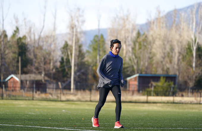 Olympic hopeful Maggie Montoya is shown as she trains with fellow runners at a park on the east side of Boulder, Colo., Friday, April 9, 2021.  The 25-year-old distance runner was working in the pharmacy at the King Soopers supermarket in Boulder, Colorado, on March 22 when 10 people were killed, including a police officer, in a mass shooting. (AP Photo/David Zalubowski)
