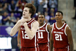 Oklahoma guard Austin Reaves (12), guard De'Vion Harmon (11) and forward Kristian Doolittle (21) celebrate in the final seconds of the second half of an NCAA college basketball game against TCU in Fort Worth, Texas, Saturday, March 7, 2020. Oklahoma won 78-76. (AP Photo/Tony Gutierrez)