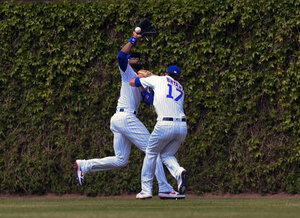 a3a60552f Cubs slugger Kris Bryant exits game after outfield collision