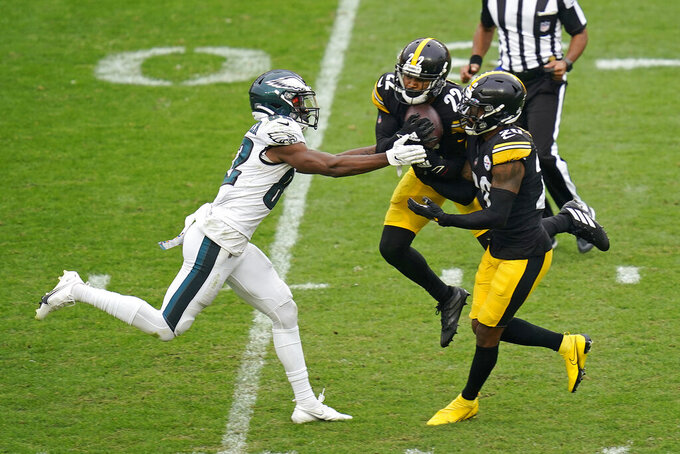 Pittsburgh Steelers cornerback Steven Nelson (22) intercepts a pass intended for Philadelphia Eagles wide receiver John Hightower (82) during the second half of an NFL football game, Sunday, Oct. 11, 2020, in Pittsburgh. The Steelers won 38-29. (AP Photo/Keith Srakocic)