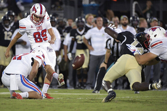 SMU place kicker Kevin Robledo (89) makes a 31-yard field goal in front of Central Florida defensive back Nevelle Clarke (14) during the first half of an NCAA college football game Saturday, Oct. 6, 2018, in Orlando, Fla. (AP Photo/Phelan M. Ebenhack)