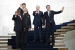 From left to right, South Africa's President Cyril Ramaphosa, China's President Xi Jinping, India's Prime Minister Narendra Modi, Russia's President Vladimir Putin and Brazil's President Jair Bolsonaro pose for a photo at the BRICS emerging economies at the Itamaraty palace in Brasilia, Brazil, Thursday, Nov. 14, 2019. (AP Photo/Pavel Golovkin, Pool)