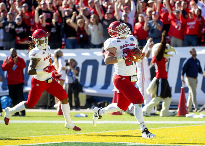 Eastern Washington running back Sam McPherson (20) is trailed by wide receiver Jayson Williams (2) as he scores on a 75-yard run against North Dakota State during the second half of the FCS championship NCAA college football game, Saturday, Jan. 5, 2019, in Frisco, Texas. North Dakota State won 38-24. (AP Photo/Jeffrey McWhorter)