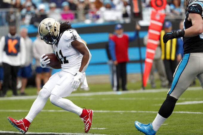 New Orleans Saints running back Alvin Kamara (41) scores a touchdown against the Carolina Panthers during the first half of an NFL football game in Charlotte, N.C., Sunday, Dec. 29, 2019. (AP Photo/Gerry Broome)