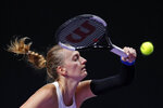 Petra Kvitova of the Czech Republic misses the ball from Ashleigh Barty of Australia during the WTA Finals Tennis Tournament at the Shenzhen Bay Sports Center in Shenzhen, China's Guangdong province, Thursday, Oct. 31, 2019. (AP Photo/Andy Wong)