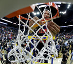 Auburn's Samir Doughty cuts the net after the Midwest Regional final game against Kentucky in the NCAA men's College basketball tournament Sunday, March 31, 2019, in Kansas City, Mo. Auburn won 77-71 in overtime. (AP Photo/Charlie Riedel)