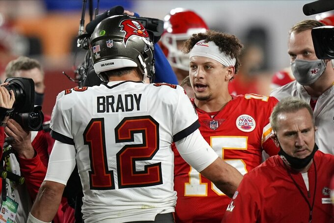 Tampa Bay Buccaneers quarterback Tom Brady, speaks with Kansas City Chiefs quarterback Patrick Mahomes after the NFL Super Bowl 55 football game, Sunday, Feb. 7, 2021, in Tampa, Fla. The Buccaneers defeated the Chiefs 31-9 to win the Super Bowl. (AP Photo/David J. Phillip)