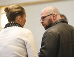 Max Misch, a self-described white nationalist, talks to his court appointed attorney Susan McManus during a hearing in a Bennington County courtroom, Thursday afternoon, Feb. 7, 2019, in Bennington, Vt. Misch, who has harassed Vermont's only female black legislator who later resigned, pleaded not guilty on Thursday to two counts of possessing illegal, large capacity gun magazines. (Holly Pelczynski/The Banner via AP)
