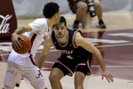 Western Kentucky guard Luke Frampton (14) guards Alabama guard Jahvon Quinerly (13) during the first half of an NCAA college basketball game, Saturday, Dec. 19, 2020, in Tuscaloosa, Ala. (AP Photo/Vasha Hunt)