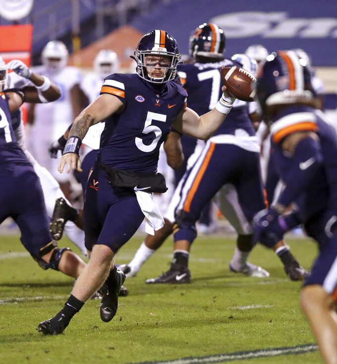 FILE - Virginia quarterback Brennan Armstrong (5) throws a pass to tight end Billy Kemp IV (4) during the team's NCAA college football game against North Carolina on Saturday, Oct. 31, 2020, in Charlottesville, Va. Armstrong is back at quarterback. (Andrew Shurtleff/The Daily Progress via AP, File)