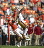 Clemson safety Nolan Turner (24) intercepts a pass intended for Boston College receiver Jaelen Gill (86) during the first half of an NCAA college football game Saturday, Oct. 31, 2020, in Clemson, S.C. (Josh Morgan/Pool Photo via AP)