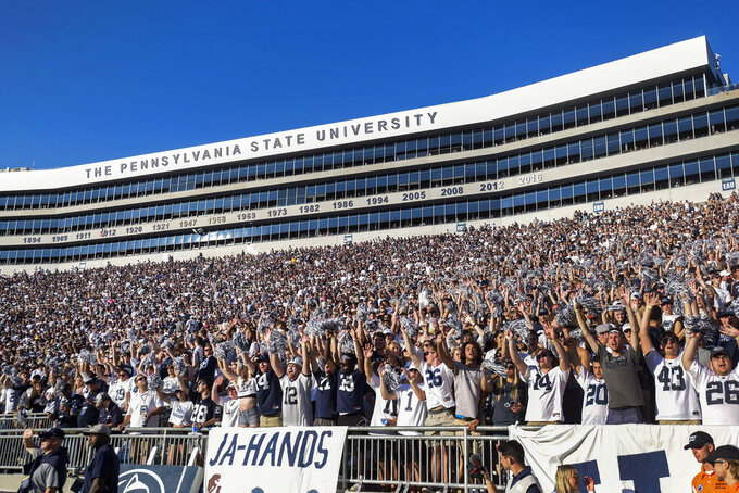 Penn State fans cheer against Ball State during an NCAA college football game in State College, Pa., on Saturday, Sept. 11, 2021. Penn State defeated Ball State 44-13. (AP Photo/Barry Reeger)