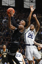 Providence guard David Duke (3) shoots in front of Butler guard Henry Baddley (20) in the second half of an NCAA college basketball game in Indianapolis, Saturday, Feb. 1, 2020. Providence defeated Butler 65-61. (AP Photo/Michael Conroy)