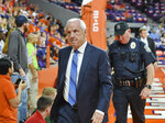 North Carolina coach Roy Williams leaves the court before the team's NCAA college basketball game against Clemson on Saturday, March 2, 2019, in Clemson, S.C. Williams collapsed with seconds left in the first half and was helped off of the court. Williams fell near the bench during the first half of a game Saturday and was led to the locker room. (AP Photo/Richard Shiro)