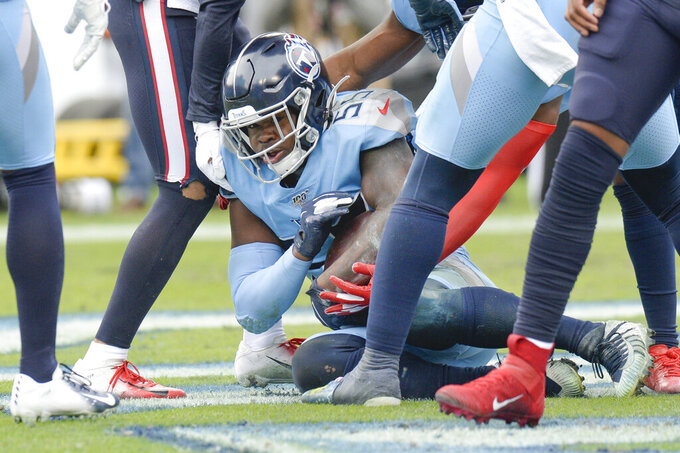 Tennessee Titans inside linebacker Jayon Brown (55) holds onto the ball in the end zone after intercepting a pass against the Houston Texans in the second half of an NFL football game Sunday, Dec. 15, 2019, in Nashville, Tenn. (AP Photo/Mark Zaleski)