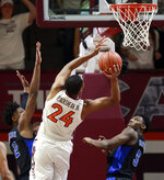 Virginia Tech's Kerry Blackshear Jr. (24) scores over Duke's Cam Reddish (2) and RJ Barrett (5) of Duke during the first half of an NCAA college basketball game in Blacksburg, Va., Tuesday, Feb. 26, 2019. (Matt Gentry/The Roanoke Times via AP)