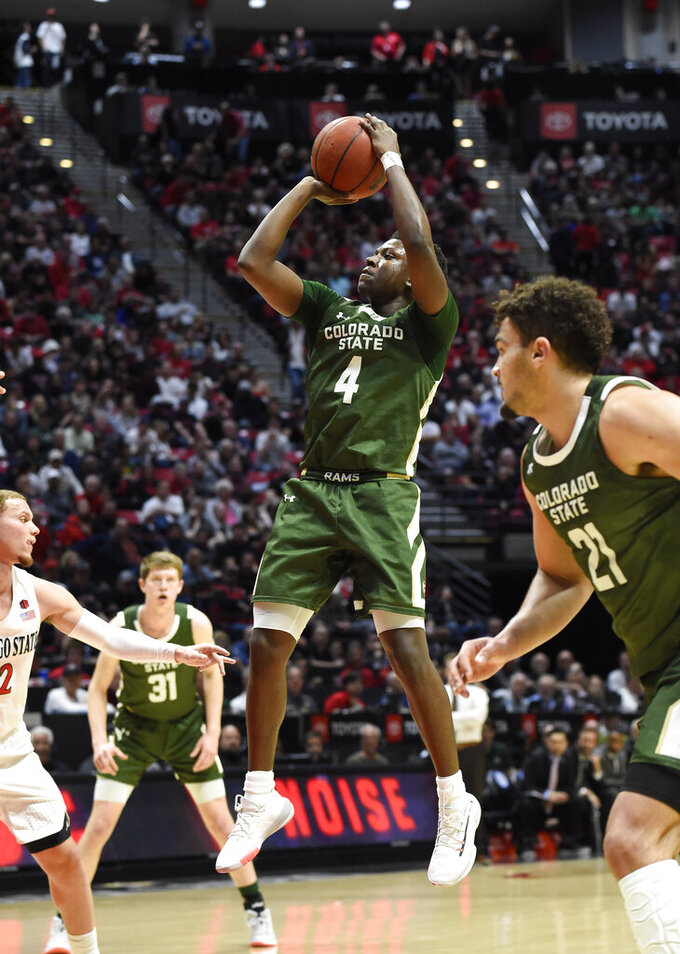 Colorado State guard Isaiah Stevens (4) shoots during the first half of the team's NCAA college basketball game against San Diego State on Tuesday, Feb. 25, 2020, in San Diego. (AP Photo/Denis Poroy)