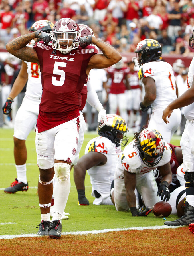 Temple linebacker Shaun Bradley (5) reacts to the defensive goal line stop of Maryland running back Anthony McFarland Jr. (5) during the second half of an NCAA college football, Saturday, Sept. 14, 2019, in Philadelphia. Temple won 20-17. (AP Photo/Chris Szagola)