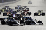 Mercedes driver Lewis Hamilton of Britain, right and Mercedes driver Valtteri Bottas of Finland, left, lead the field after the start during Formula One Grand Prix at the Baku Formula One city circuit in Baku, Azerbaijan, Sunday, April 28, 2019. (AP Photo/Sergei Grits)