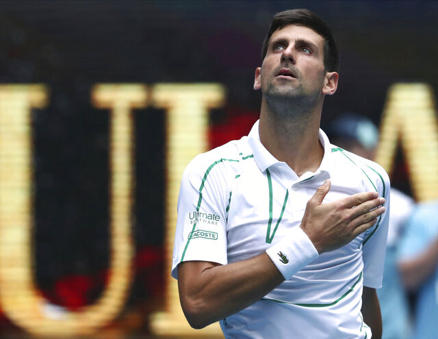 Serbia's Novak Djokovic celebrates after defeating Japan's Tatsuma Ito in their second round singles match at the Australian Open tennis championship in Melbourne, Australia, Wednesday, Jan. 22, 2020. (AP Photo/Dita Alangkara)