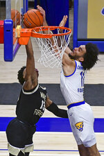 Pittsburgh forward Justin Champagnie blocks the shot of Wake Forest guard Quadry Adams during the second half of an NCAA college basketball game, Tuesday, March 2, 2021, in Pittsburgh. (AP Photo/Fred Vuich)