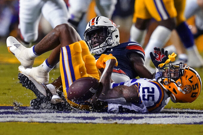 LSU cornerback Cordale Flott (25) breaks up a pass intended for Auburn wide receiver Kobe Hudson in the first half of an NCAA college football game in Baton Rouge, La., Saturday, Oct. 2, 2021. (AP Photo/Gerald Herbert)