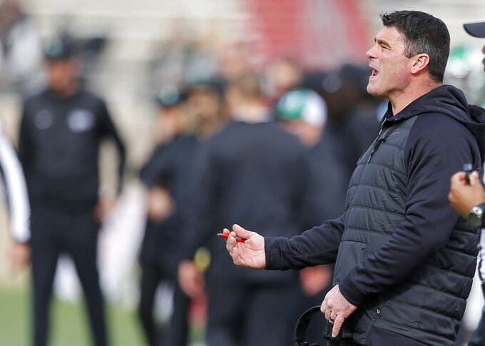 North Texas coach Seth Littrell yells to his players during a time out in the first half of the New Mexico Bowl NCAA college football game against Utah State in Albuquerque, N.M., Saturday, Dec. 15, 2018. Utah State won 52-13. (AP Photo/Andres Leighton)