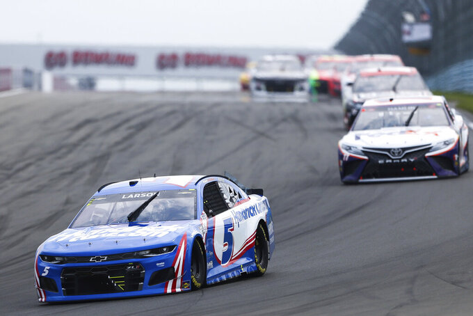 Kyle Larson (5) rounds Turn 1 during a NASCAR Cup Series auto race in Watkins Glen, N.Y., on Sunday, Aug. 8, 2021. (AP Photo/Joshua Bessex)