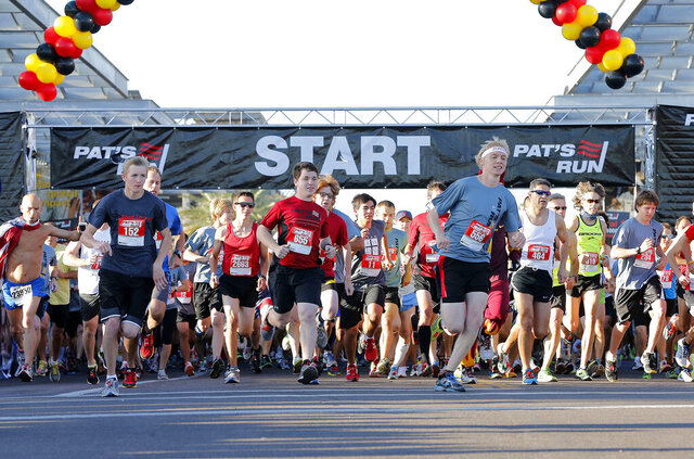 FILE - In this April 20, 2013, file photo, runners start the 9th annual Pat's Run in Tempe, Ariz. Pat's Run annually draws 30,000 people to run in honor former NFL player and soldier Pat Tillman. The coronavirus pandemic forced organizers join several other races in shifting it to a virtual event.  (AP Photo/Matt York, File)