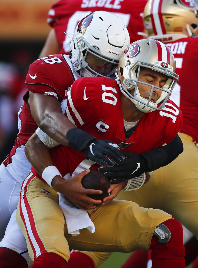 San Francisco 49ers quarterback Jimmy Garoppolo (10) is sacked by Arizona Cardinals middle linebacker Jordan Hicks during the first half of an NFL football game in Santa Clara, Calif., Sunday, Nov. 17, 2019. (AP Photo/John Hefti)