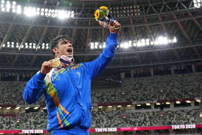 Gold medalist Neeraj Chopra, of India, poses during the medal ceremony for the men's javelin throw at the 2020 Summer Olympics, Saturday, Aug. 7, 2021, in Tokyo. (AP Photo/Martin Meissner)