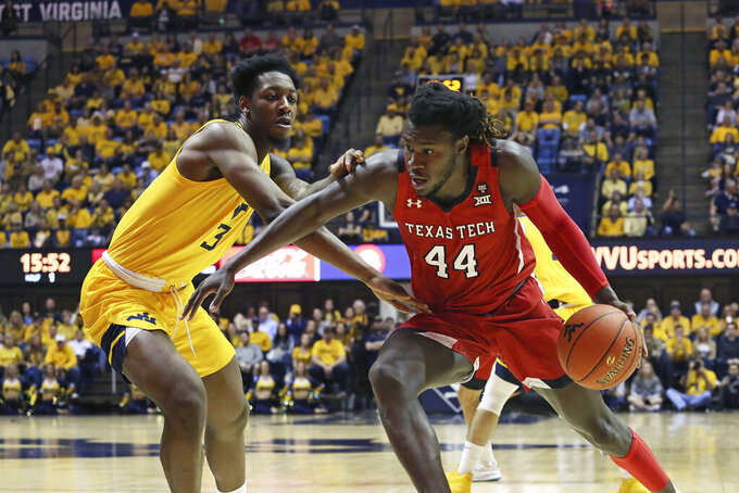 Texas Tech guard Chris Clarke (44) runs upcourt as he is defended by West Virginia forward Gabe Osabuohien (3) during the first half of an NCAA college basketball game Saturday, Jan. 11, 2020, in Morgantown, W.Va. (AP Photo/Kathleen Batten)