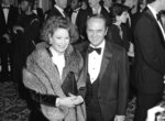 FILE - This Jan. 26, 1985 file photo shows actor-comedian Bob Newhart, right and his wife Ginny at the Golden Globe Awards in Beverly Hills, Calif. Newhart is celebrating his 90th birthday on Thursday, and he's got big plans: spending the day with his wife of 56 years, Ginnie, and their children. The comedian and actor said he considers laughter the key to longevity in marriage and in life. (AP Photo/Lennox McLendon, File)