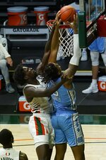 North Carolina forward Armando Bacot (5) goes for a basket as Miami center Nysier Brooks (3) defends, during the second half of an NCAA college basketball game, Tuesday, Jan. 5, 2021, in Coral Gables, Fla. (AP Photo/Marta Lavandier)