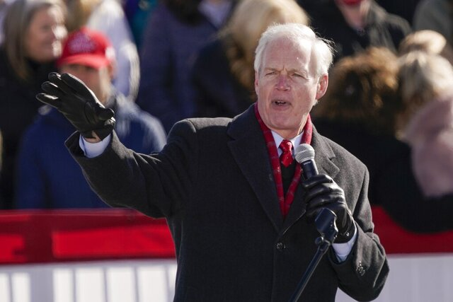 FILE - In this Oct. 30, 2020 file photo, Sen. Ron Johnson, R-Wis, speaks before President Donald Trump at a campaign rally, at the Austin Straubel Airport in Green Bay, Wis. Sen. Johnson says he has not made a decision yet on his political future as the vocal backer of President Donald Trump faces two years in the minority and mounting calls for him to step aside. Johnson texted The Associated Press on Thursday, Jan. 7, 2021, to say he had not yet made a decision. (AP Photo/Morry Gash, File)