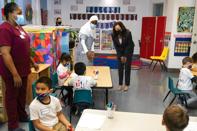 Vice President Kamala Harris greets bilingual early childhood education school CentroNia pupils during a visit to the school, Friday, June 11, 2021 in northwest Washington. Harris talked about child tax credit during the visit. (AP Photo/Manuel Balce Ceneta)