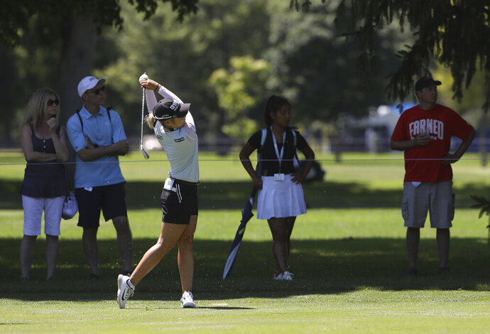 After dropping the ball in the No. 7 fairway, Jeongeun Lee6 hits to the green during the LPGA Marathon Classic golf tournament at Highland Meadows Golf Club in Sylvania, Ohio, Friday, July 12, 2019. (Lori King/The Blade via AP)