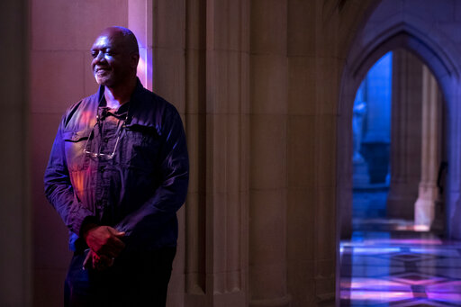 Artist Kerry James Marshall poses for a portrait in the National Cathedral after being selected to design a replacement of former confederate-themed stained glass windows that were taken down in 2017, in Washington, Thursday, Sept. 23, 2021. (AP Photo/Andrew Harnik)