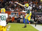 Green Bay Packers' Jimmy Graham reacts after catching a touchdown pass during the first half of an NFL football game against the Chicago Bears Thursday, Sept. 5, 2019, in Chicago. (AP Photo/Charles Rex Arbogast)
