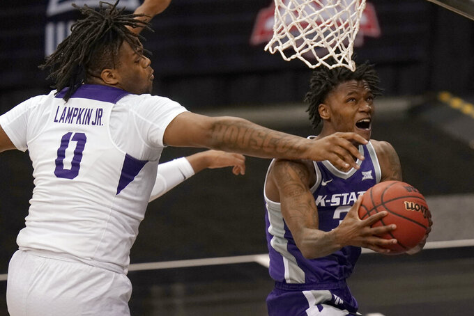 Kansas State guard DaJuan Gordon (3) drives past TCU center Eddie Lampkin (0) during the second half of an NCAA college basketball game in the first round of the Big 12 men's tournament in Kansas City, Mo., Wednesday, March 10, 2021. (AP Photo/Orlin Wagner)