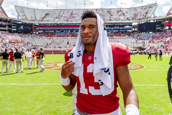 Alabama quarterback Tua Tagovailoa (13) walks off the field victorious celebrate after a 49-7 win over Southern Miss in an NCAA college football game, Saturday, Sept. 21, 2019, in Tuscaloosa, Ala. (AP Photo/Vasha Hunt)