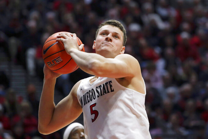 FILE - In this Jan. 11, 2020, file photo, San Diego State forward Yanni Wetzell during the second half of an NCAA college basketball game against Boise State in San Diego. It's almost like coach Brian Dutcher and the San Diego State Aztecs won the lottery. Tired of losing at their old schools, big man Yanni Wetzell and guards Malachi Flynn and KJ Feagin transferred to San Diego State after being lured by the prospect of winning and going to the NCAA Tournament. And boy, have they ever won, to the point that they've matched some accomplishments by the breakthrough 2010-11 team led by the most famous player in program history, Kawhi Leonard. (AP Photo/Gregory Bull, File)
