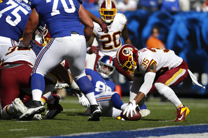Washington Redskins' Montae Nicholson recovers a fumble during the second half of an NFL football game against the New York Giants, Sunday, Sept. 29, 2019, in East Rutherford, N.J. (AP Photo/Adam Hunger)