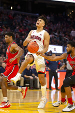 Arizona guard Josh Green (0) is fouled by St. John's guard LJ Figueroa (30) on a fast break during the second half of an NCAA college basketball game Saturday, Dec. 21, 2019, in San Francisco. St. John's defeated Arizona 70-67. (AP Photo/D. Ross Cameron)