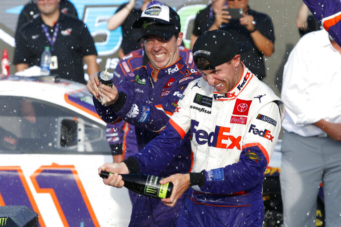 Denny Hamlin celebrates in victory lane after winning the NASCAR Cup Series auto race at ISM Raceway, Sunday, Nov. 10, 2019, in Avondale, Ariz. (AP Photo/Ralph Freso)