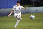LA Galaxy forward Cristian Pavon connects on a penalty kick during the second half of the team's MLS soccer match against the Portland Timbers, Monday, July 13, 2020, in Kissimmee, Fla. (AP Photo/Phelan M. Ebenhack)
