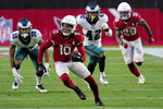 Arizona Cardinals wide receiver DeAndre Hopkins (10) runs after the catch as Philadelphia Eagles safety K'Von Wallace (42) pursues during the second half of an NFL football game, Sunday, Dec. 20, 2020, in Glendale, Ariz. (AP Photo/Ross D. Franklin)