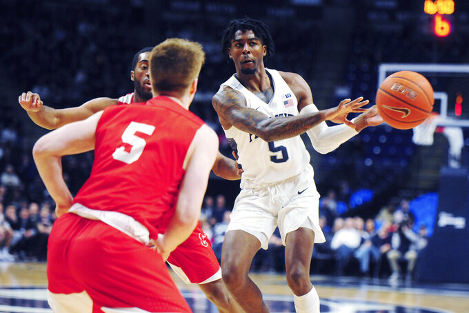 Penn State's Jamari Wheeler (5) passes around Cornell's Bryan Knapp (5) during first half action of an NCAA college basketball game, Sunday, Dec. 29, 2019, in State College, Pa. (AP Photo/Gary M. Baranec)
