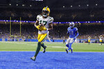 Green Bay Packers wide receiver Davante Adams (17) runs into the end zone after a 20-yard reception for a touchdown during the second half of an NFL football game against the Detroit Lions, Sunday, Dec. 29, 2019, in Detroit. (AP Photo/Rick Osentoski)